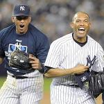 Relief pitcher Mariano Rivera of the New York Yankees celebrates with Alex Rodriguez after beating the Los Angeles Angels of Anaheim in New York